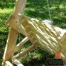 Деревянные садовые качели Сенди Л некрашеные вид на лавку сзади. Механизм регулировки наклона спинки лавки